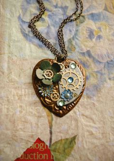 Steampunk Heart Necklace - Steampunk Heart with Watch Gears and Green Enamel Flower - Steampunk Dolly Kei. $50.00, via Etsy.