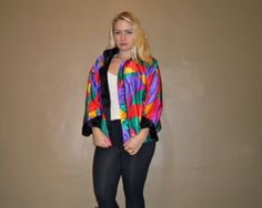 This is a vintage 90s hot neon pink, purple, green, red, and yellow stain glass design windbreaker jacket. This is an awesome reversible jacket