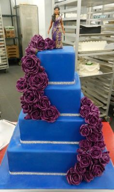 Blue base and cascading purple roses
