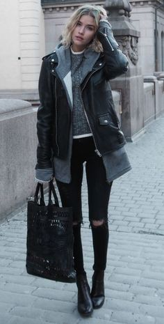 Elsa Ekman + simple yet edgy fall style + knitted sweater + hoodie + oversized leather jacket + distressed jeans + leather boots + matching bag!  Jacket: Deadwood, Jeans: Cheap Monday, Boots: Feet First, Bag: DAY Birger et Mikkelsen.