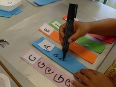 name writing practice - for each letter in a child's name - looks like a job for my paint color strips! Write a letter in each color box.