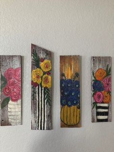Barnboard floral paintings.