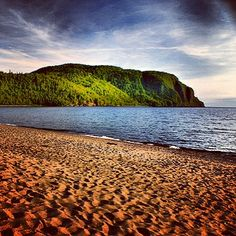 Old Woman Bay on the shore of Lake Superior near Wawa Ontario. Along the highway, it is gorgeous.all you see is the long beach, & the huge rock face. Would love, love, love to hike & camp here one day! Travel English, Lake Superior, Great Lakes, Canada Travel, Natural Wonders, Long Beach, Vacation Destinations, Road Trips, Ontario
