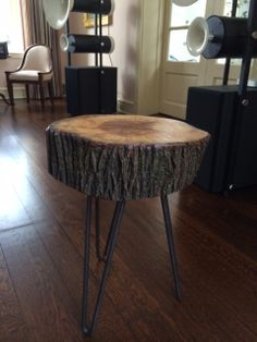 "18"" Round x 6"" Thick Slice of Log with Metal Hairpin Legs.  Overall height: 22"" high.  Satin finish adds to the natural feel of the piece."