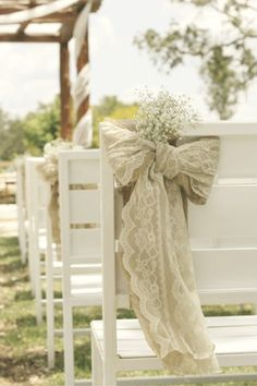 Vintage Rustic Chair Tie accented with babies breath at Memory Lane Event Center!