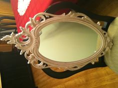 This vintage piece is a beauty. It was a gold resin framed mirror, in perfect condition considering it's age (circa 1960s). It has been freshly painted in a pale shabby french couture pink, and lightly distressed to have the gold peaking through. It really is a shabby chic beauty with simple elegance. It would be the perfect addition to your country chic decor. Price: $125.00. If you are interested in this item, please contact me for a shipping quote.