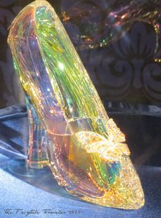 The coveted glass slipper from Cinderella movie 2015 made entirely of Swarovski crystal as seen at the red carpet world premiere during the Cinderella Costume Exhibit. Costume designer for the film, Sandy Powell brings high fashion to fairy tale in the colorful and dramatic all new Cinderella 2015.