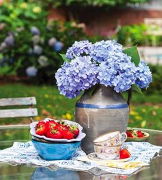 We're welcoming July with fresh strawberries and hydrangeas clipped from the yard, two summertime favorites!
