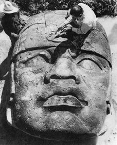 Excavation of an Olmec colossal head with excavators,  in the coastal region of southern Veracruz in Mexico, carved c. 1200-900 BC