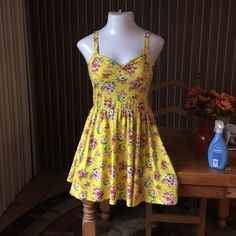 Aeropostale Yellow Floral Sundress in Size Large ADORABLE- Like New- Aeropostale Yellow Sundress with Pink Flowers all over. Size Large. RETAIL $79.00 Aeropostale Dresses Mini