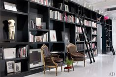 Floor-to-ceiling bookshelves line a hallway at Ralph Rucci's New York headquarters