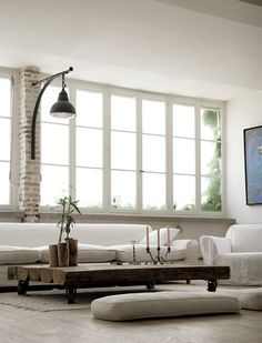 Absolutely LOVE the light on the brick. Can't pull off white couches, would change these to blue denim