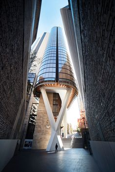 fjmt studios kinetic tower of wood transcends grey skyscrapers in sydney