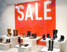 This display allows the store to tell customers that the boots and shoes infront of this sign are on sale. While still having the shoes/boots on top of boxes and shelves.
