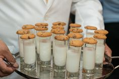 milk and cookies served in shot glasses for reception.
