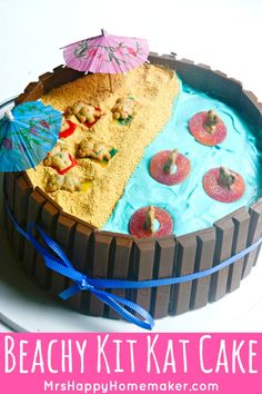 This Beach Scene Kit Kat Cake is the cutest! It's so easy that even people who aren't good cake decorators, like me, can put it together in a jiffy! | MrsHappyHomemaker.com