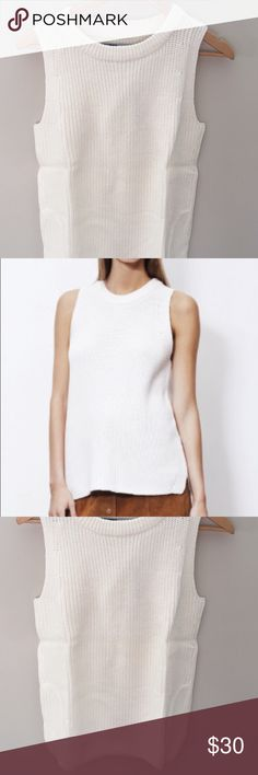Just Female Ashley Knit The Ashley knit top from Just Female is an all over rib knit sleeveless sweater tank featuring a slight side slit on each side and tapered hem.     Color: CREAM.  100% Cotton just female  Tops Tank Tops