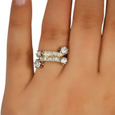 This ravishing wedding ring from the Edwardian era is a vision in diamonds and romantic rose gold.