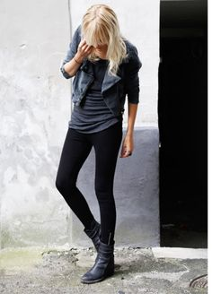 Black leather boots, dark leather jacket, gray top and black skinny jeans