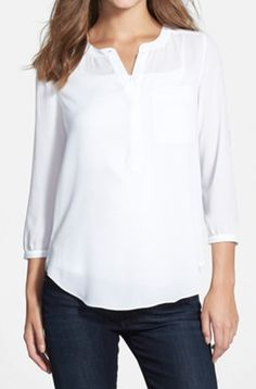 basic henley blouse - pair with a fun skirt or trouser. Don't forget to accessorize !