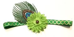 This womens Boho Chic headband features a green silk flower with a bronze glitter center and glitter peacock feather. Headband is sized for