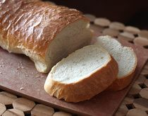 Crusty French Bread Recipe - Bread Machine The recipe say it only makes one loaf but the instruction has you make two portions so I count that as 2 loaves.  Smelled amazing in my oven have not dug into these beauties yet!