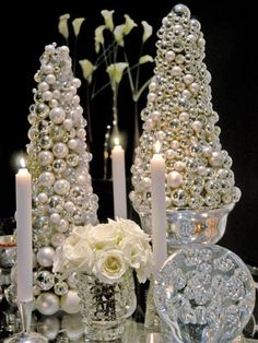"For a striking addition to any table, create a small silver ""tree."" Buy an 18-inch-tall Styrofoam cone form, and completely cover it with small Christmas balls in matte and shiny finishes. in a silver bowl"