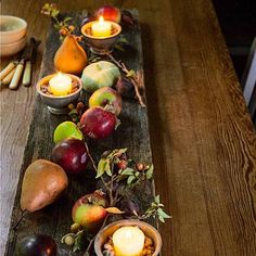 Love the idea of using a board as the base for any table decorations, much like this warm fall display.  I use my Snowbabies collection over the Christmas holidays as my dining room centerpiece and it takes so long to set up, I dread needing to change the tablecloth underneath!  If the centerpiece was on a board, a couple of people could lift either end and move off the table to change linens, etc.