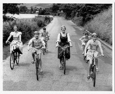 "Julie Andrews, Charmian Carr, Nicholas Hammond, Duane Chase, Angela Cartwright, Debbie Turner and Kym Karath ride bikes. And sing ""Do-Re-Mi."""