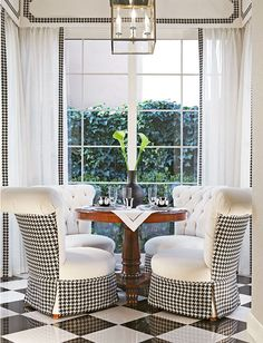 Eye-catching houndstooth contrast on chairs and window treatment I Dorya Interiors.