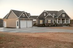 Craftsman style home. Gray with white windows. Stone, Hardi Plank, & Cedar Shake Siding.  North Point Custom Builders, Shelby NC.