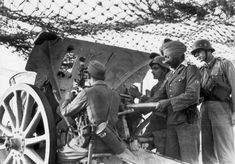 Indian soldier of the Free Indian Legion (Freies_Indien) attached to Waffen SS-troops mans an artillery piece; 1944 [800 x 559]
