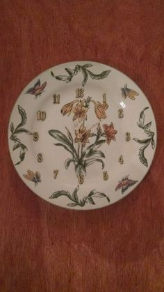 This frilly floral 10 5/8 inch clock will add beauty to any room in your house. This clock will brighten up your days, and be quite a conversation piece. See more beautiful clocks and rare and valuable collector plates at GiftyGold.com. Make Gifty Gold your single source for your gift-giving needs. Gift wrapping available upon request.   eBay!
