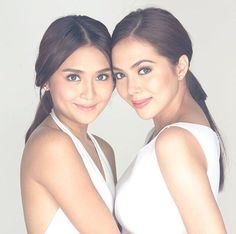 This is Kathryn Bernardo and Julia Montes posing for the camera together for a commercial endorsement poster for Air Optix Contact Lenses. They're very amazing and talented commercial models and endorsers. They'll be the next Kylie Jenner and Kendall Jenner of the Philippines, of ABS-CBN, and of Star Magic.