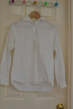 Size 6 regular Land's End white dress shirt, no stains, spots or holes.
