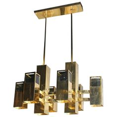 Robert Sonneman Brass Chandelier Cube Smoked Lucite Cityscape Column   From a unique collection of antique and modern chandeliers and pendants at https://www.1stdibs.com/furniture/lighting/chandeliers-pendant-lights/