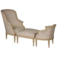 Late 19th Century French Louis XVI Style Carved and Painted Duchesse Brisee having tall bergere, ottoman, and short bergere, all upholstered in linen. Raised on turned and fluted legs.