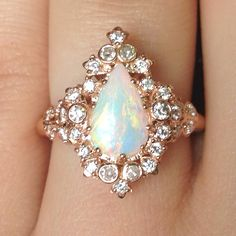 Luckiest girl alive. Custom made engagement ring by BVLA. Teardrop opal and 7 diamonds from 3 different cherished heirloom rings. Rose gold, white opal, and diamonds.