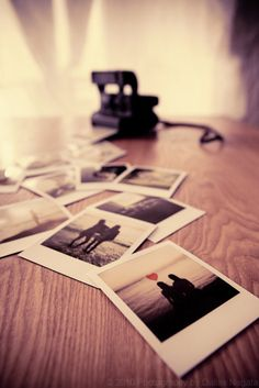 Polaroid pictures and camera