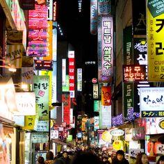 Seoul, South Korea market photograph, exterior architecture, night light signs…