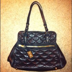 Authentic Badgley Mischka black leather Purse!! Authentic Badgley Mischka black purse- feels unbelievably soft- like Chanel lamb skin!! Inside is very roomy and in very nice condition for a pre owned purse- outside shows some wear on trim from use- minor spots on leather in places- has the gold hang tag- wear on handles from use- but overall and AMAZING BADGLEY MISCHKA Purse!!!! Badgley Mischka Bags Shoulder Bags