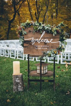wooden wedding signs - photo by Ed and Aileen Photography http://ruffledblog.com/handcrafted-wedding-with-a-doily-hoop-ceremony-backdrop