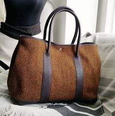 Hermes Garden Party 36cm RM 5990 (£1100/€1300/$1400) Brown wool mix leather nsilver hardware . condition very good .