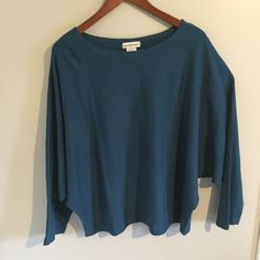 Blue Batwing Sweater This sweater has a long sleeve batwing effect and is very comfortable. It also has a line going down the middle of the sweater. Jessica London Sweaters Shrugs & Ponchos