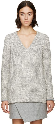 Long sleeve thick-knit sweater in marled grey and white. Raglan sleeves. V-neck collar. Tonal stitching.