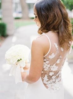 The back of this wedding dress is heavenly! Photography : Bonnie Sen Read More on SMP: http://www.stylemepretty.com/2016/08/26/st-regis-washington-dc-ballroom-real-wedding/