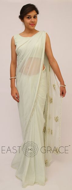 Classy girls wear pearls. We took it to a higher level and embedded them with touch, love, and care on the serene Pearl & Icy Mint Saree that's made with sheer yet royal pure silk chiffon. This saree will help you stun with a little laid-back glamour and complement your simplicity with ease. PRICE: INR 6,528.00; USD 96.00 To buy click here: www.eastandgrace.com/products/pearl-embellished-mint-saree For help reach us at care@eastandgrace.com. With love www.eastandgrace.com