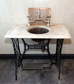 Sewing machine base sink. We have singer sewing machine bases to recreate this awesome sink!