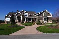 Lane Myers Construction Custom Home Builder Field of Dreams Home Gray Tiling Stone Exterior White Trim