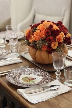 Use seasonal autumn flowers such as broom cob, roses, and mums to fill your DIY pumpkin vase.   Get the tutorial at Everyday Occasions.   - CountryLiving.com